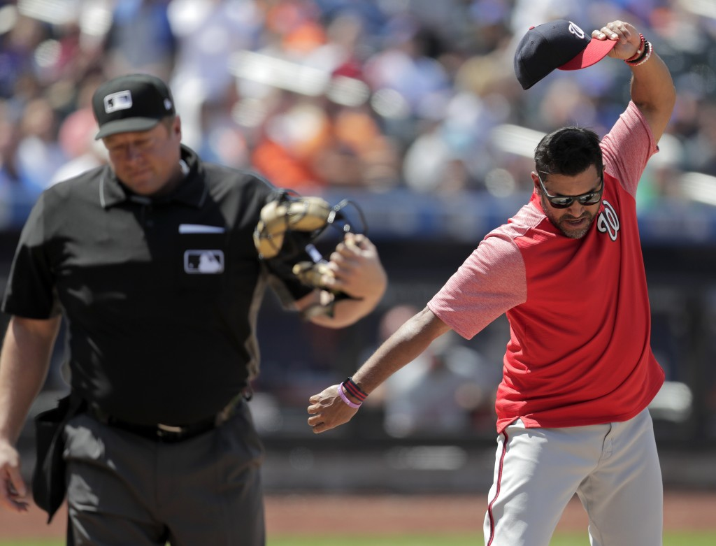 Washington Nationals manager Dave Martinez, right, reacts after being ejected by home plate umpire Bruce Dreckman for arguing after Nationals' Howie K...