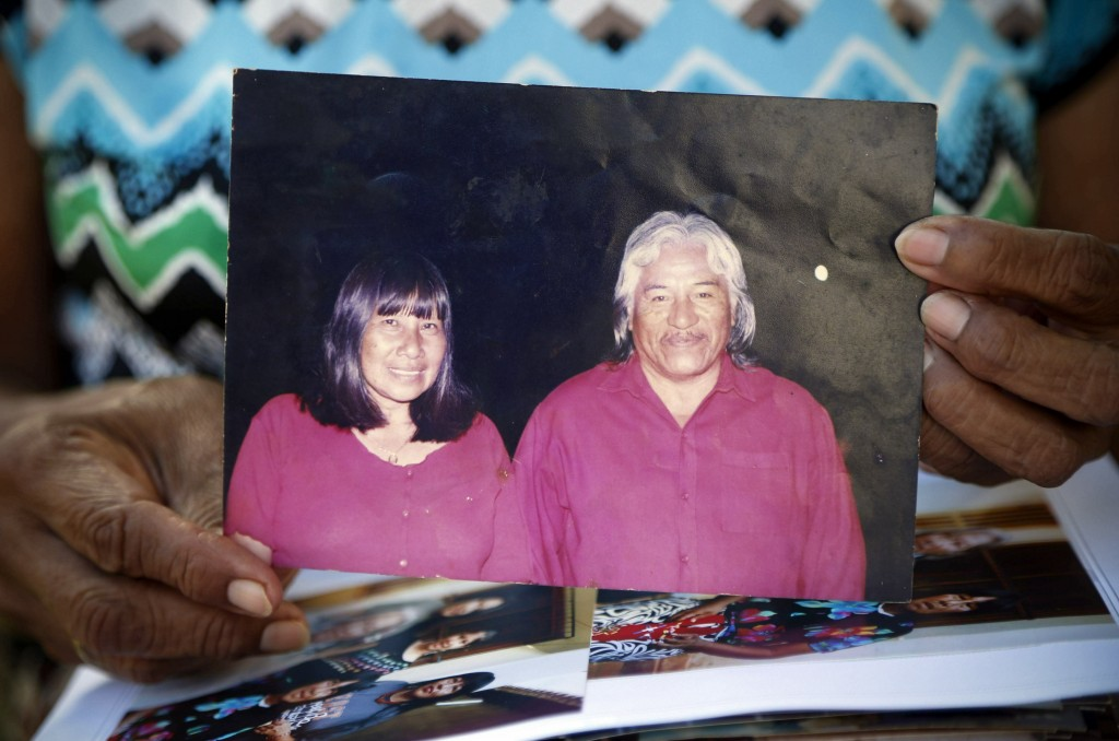 Maka indigenous leader-in-training Tsiweyenki, or Gloria Elizeche in Spanish, holds an undated portrait of herself with her husband Andres Chemei in M