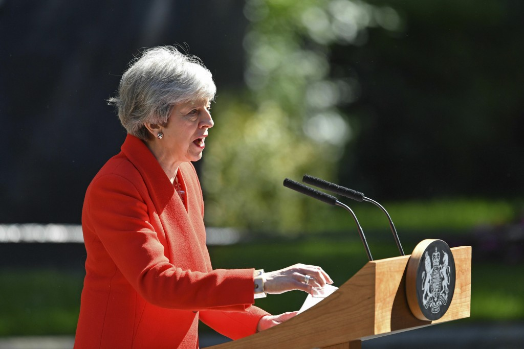 Britain's Prime Minister Theresa May makes a statement outside at 10 Downing Street in London, Friday May 24, 2019. Theresa May says she'll quit as UK