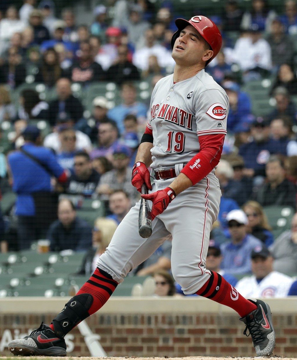 Cincinnati Reds' Joey Votto reacts after striking out swinging during the first inning of a baseball game against the Chicago Cubs, Friday, May 24, 20...