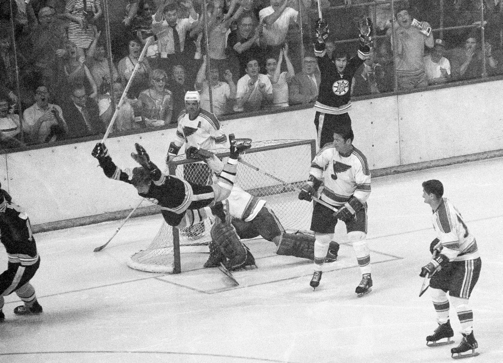 FILE - In this May 10, 1970, file photo, Boston Bruins' Bobby Orr flies through the air after scoring the winning goal past St. Louis Blues' goalie Gl...
