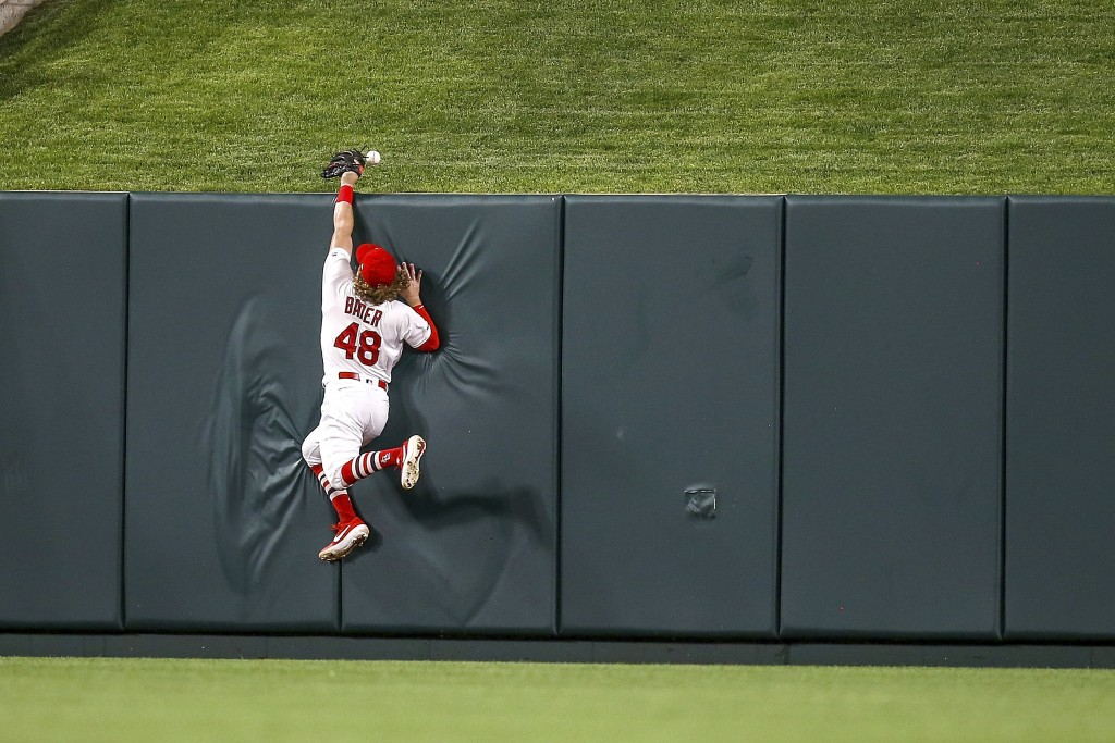 St. Louis Cardinals center fielder Harrison Bader (48) is unable to catch a two-run home run hit by Atlanta Braves' Dansby Swanson during the eighth i