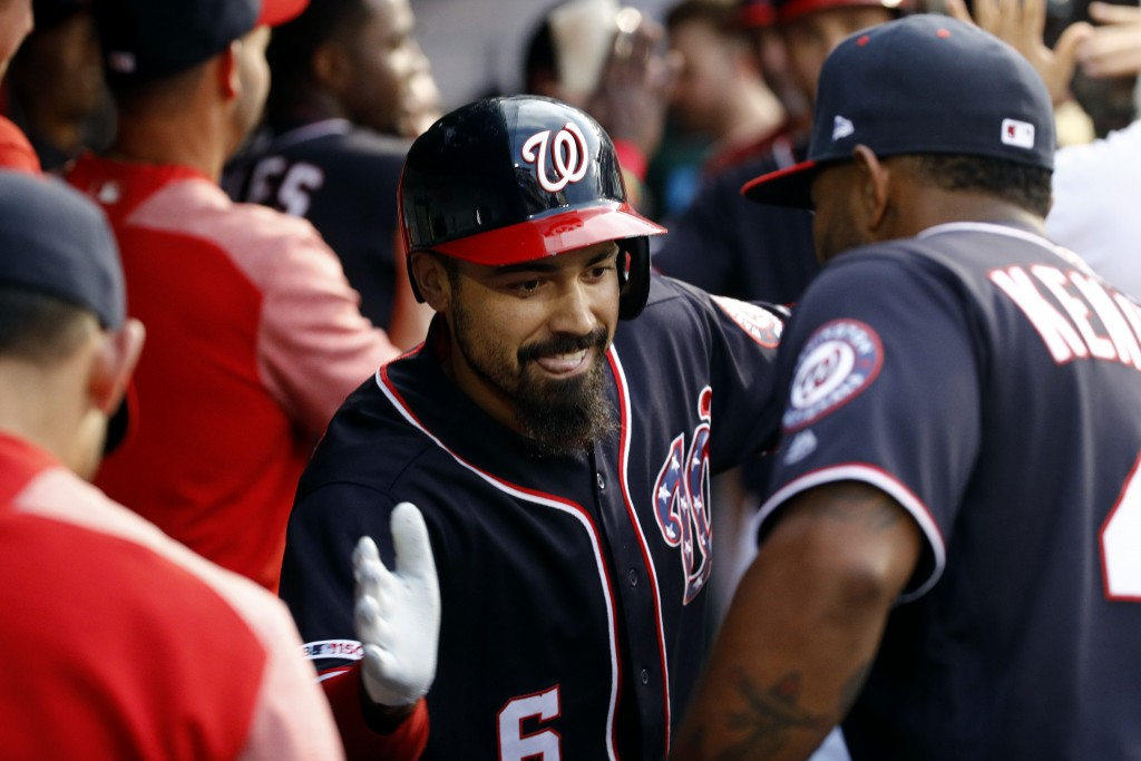 Washington Nationals' Anthony Rendon, center, celebrates his two-run home run with teammate Howie Kendrick, right, in the fourth inning of a baseball ...