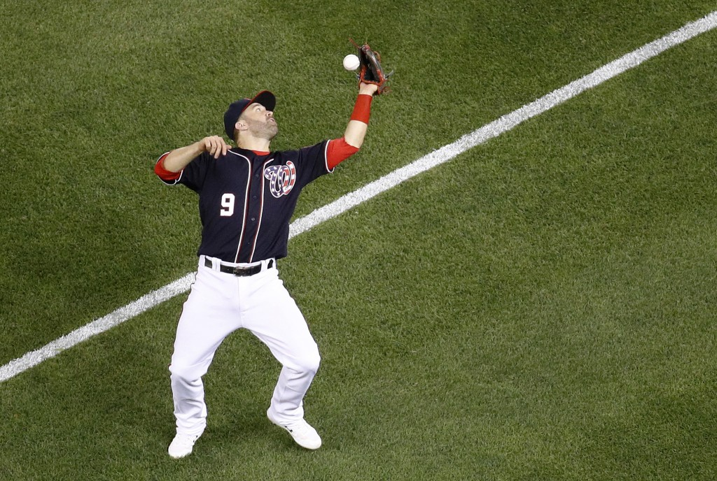 Washington Nationals second baseman Brian Dozier bobbles a foul pop fly that was hit by Miami Marlins' Harold Ramirez in the seventh inning of a baseb