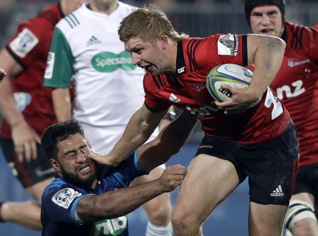 Crusaders Jack Goodhue, right, fends off Blues Akira Ioane during their Super Rugby match in Christchurch, New Zealand, Saturday, May 25, 2019. (AP Ph