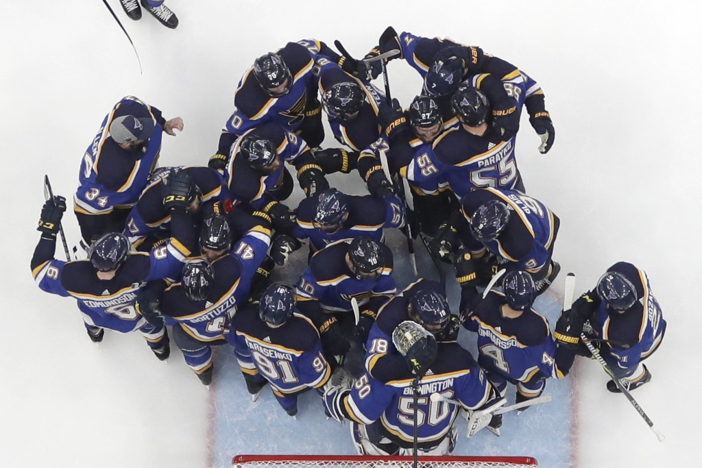 FILE - In this Tuesday, May 21, 2019 file photo, the St. Louis Blues celebrate after beating the San Jose Sharks in Game 6 of the NHL hockey Stanley C...