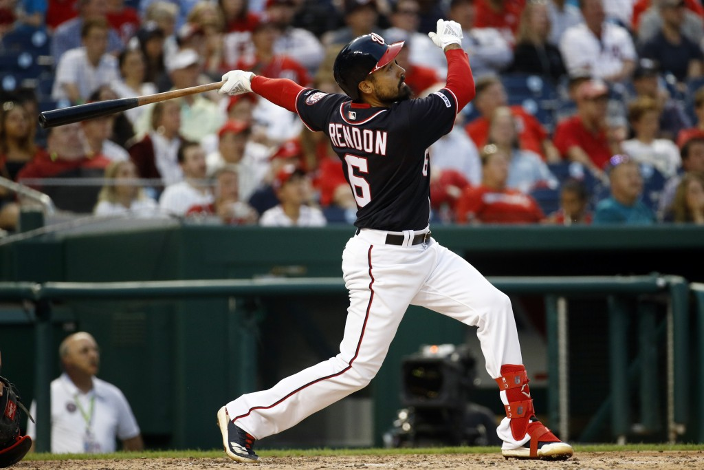 Washington Nationals' Anthony Rendon watches his two-run home run in the third inning of a baseball game against the Miami Marlins, Friday, May 24, 20...