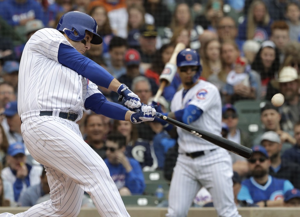 Chicago Cubs' Anthony Rizzo hits a solo home run during the third inning of a baseball game against the Cincinnati Reds, Friday, May 24, 2019, in Chic...