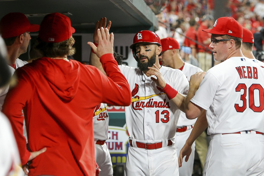 St. Louis Cardinals' Matt Carpenter (13) is congratulated by teammates after hitting a solo home run during the ninth inning of a baseball game agains