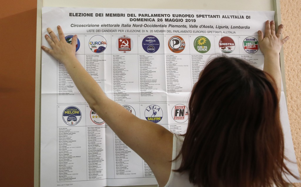 List of candidates are placed in a polling station ahead of Sunday's European Elections, in Rozzano, near Milan, Italy, Saturday, May 25, 2019. Some 4