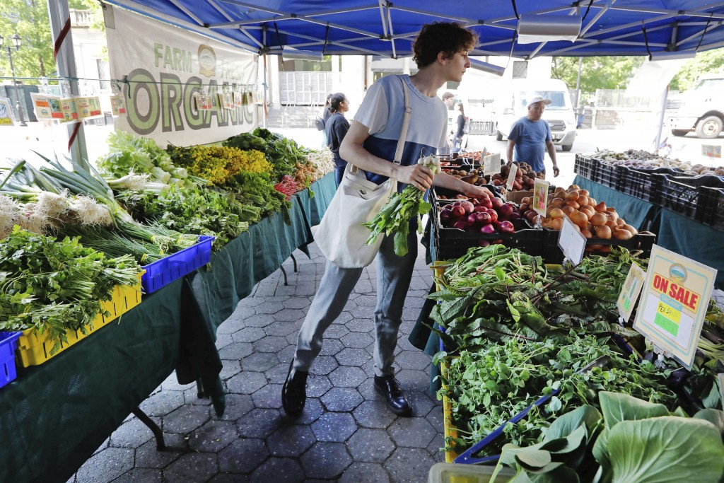 In this May 20, 2019 photo, Jonah Reider shops for vegetables in New York's Union Square Greenmarket. Reider became a national sensation when he was a...