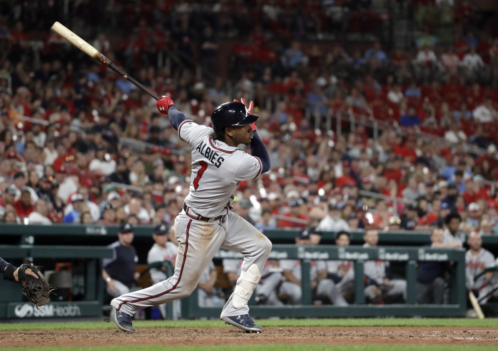 Atlanta Braves' Ozzie Albies watches his RBI single during the ninth inning of a baseball game against the St. Louis Cardinals Sunday, May 26, 2019, i...
