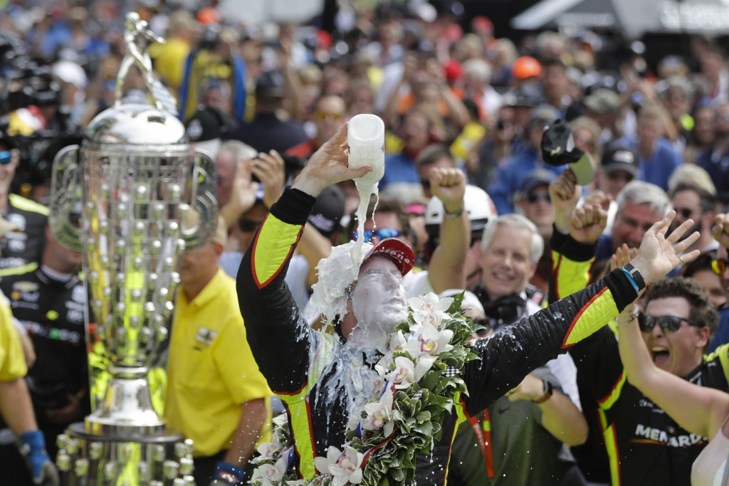 Simon Pagenaud, of France, celebrates after winning the Indianapolis 500 IndyCar auto race at Indianapolis Motor Speedway, Sunday, May 26, 2019, in In...
