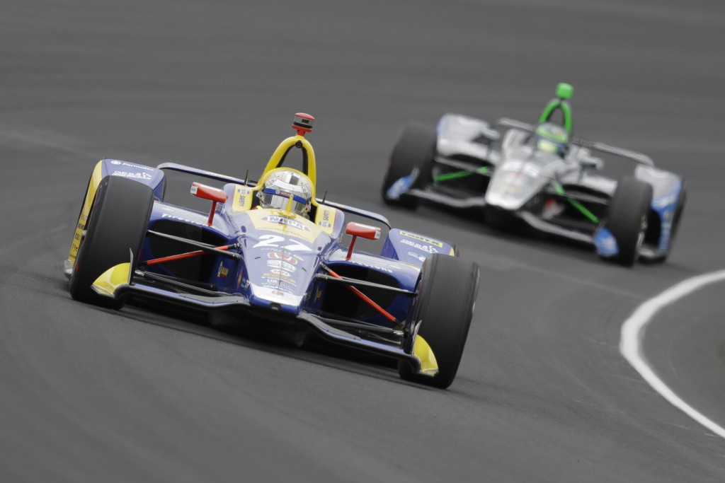 Alexander Rossi leads Conor Daly through the first turn during the Indianapolis 500 IndyCar auto race at Indianapolis Motor Speedway, Sunday, May 26, ...