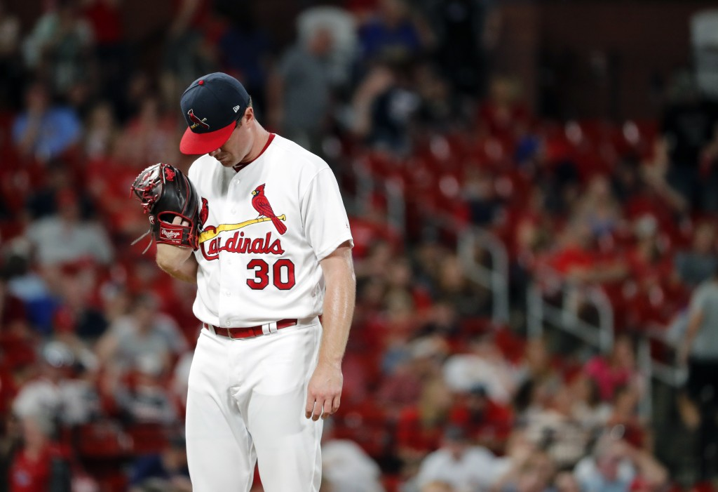 St. Louis Cardinals relief pitcher Tyler Webb waits to be removed after giving up a bases-loaded walk to Atlanta Braves' Brian McCann, scoring Freddie...