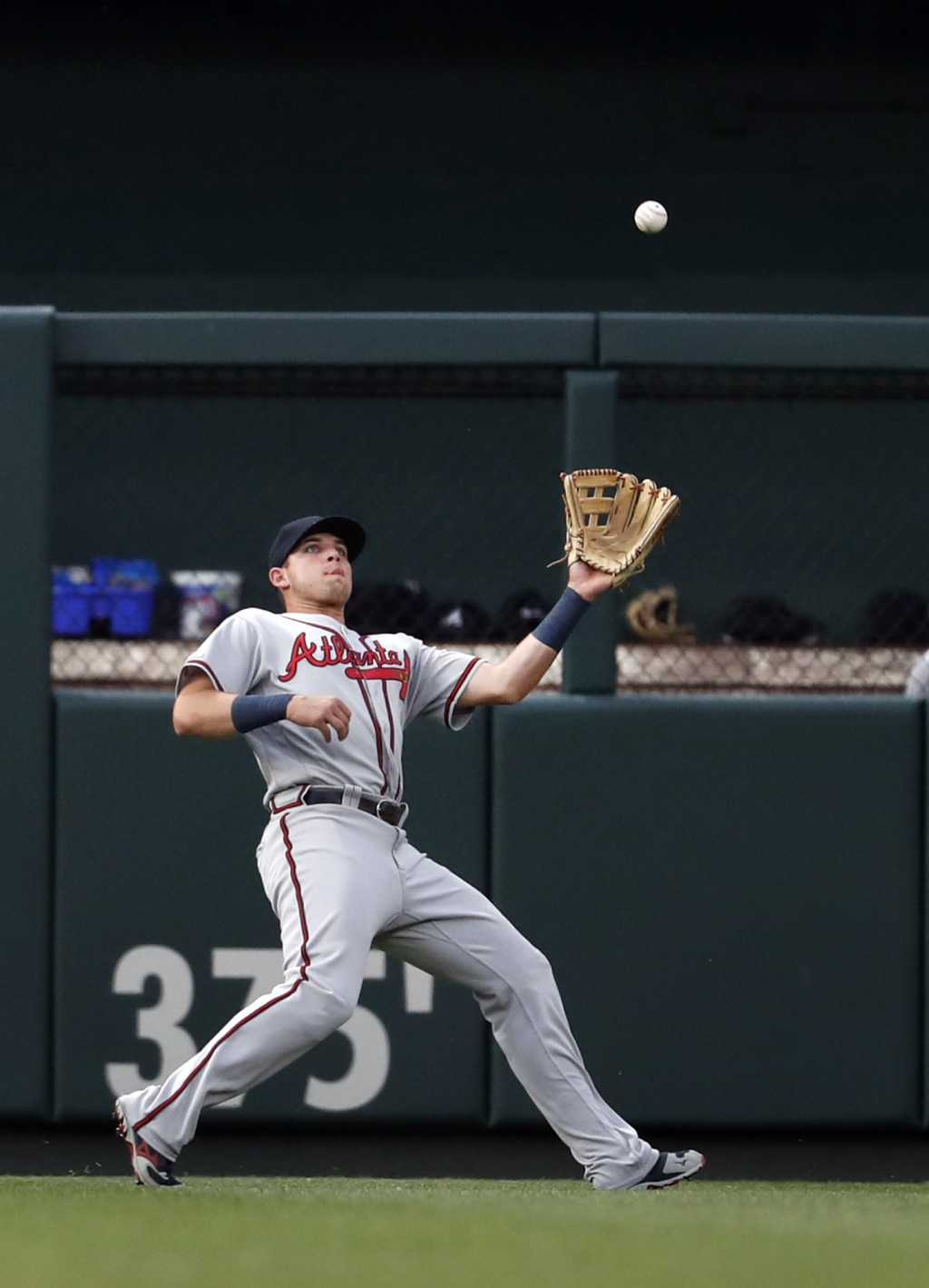 Atlanta Braves left fielder Austin Riley is unable to catch a fly ball by St. Louis Cardinals' Kolten Wong during the fourth inning of a baseball game