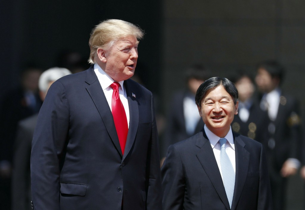 U.S. President Donald Trump, left, is escorted by Japan's Emperor Naruhito during an welcome ceremony at the Imperial Palace in Tokyo Monday, May 27, ...