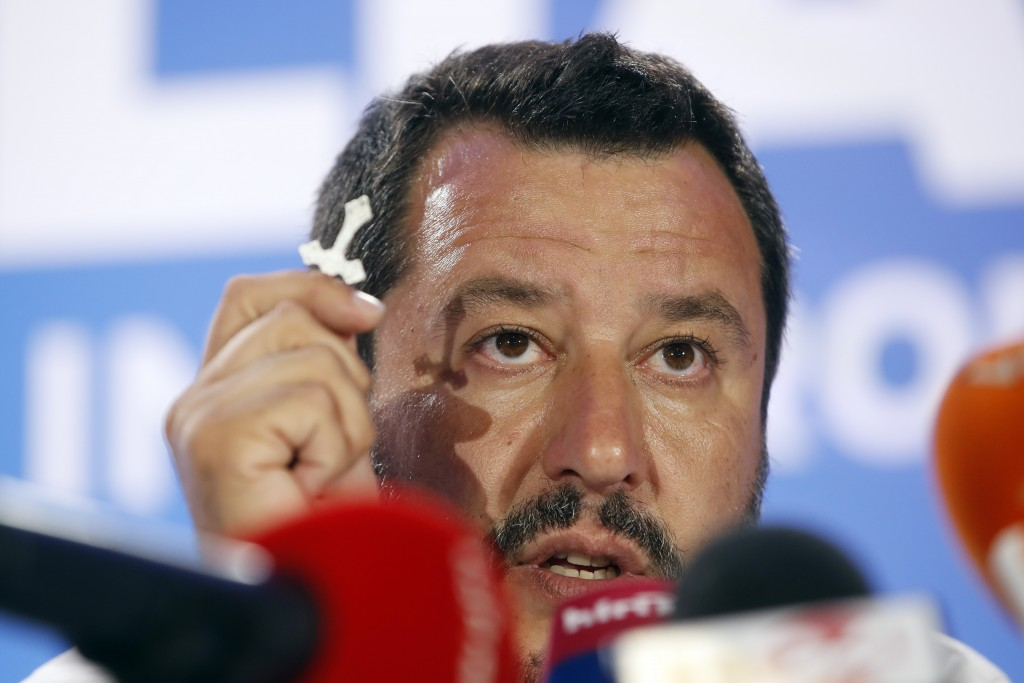 Italian Interior Minister and Deputy Premier Matteo Salvini, of the League, holds a crucifix as he talks to reporters during a press conference at the...