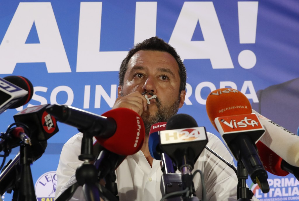 Italian Interior Minister and Deputy Premier Matteo Salvini, of the League kisses a crucifix as as he talks to reporters during a press conference at ...