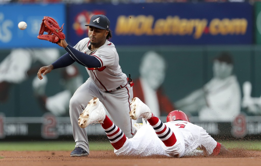 St. Louis Cardinals' Dexter Fowler, right, is safe at second for a stolen base ahead of the tag from Atlanta Braves second baseman Ozzie Albies during...