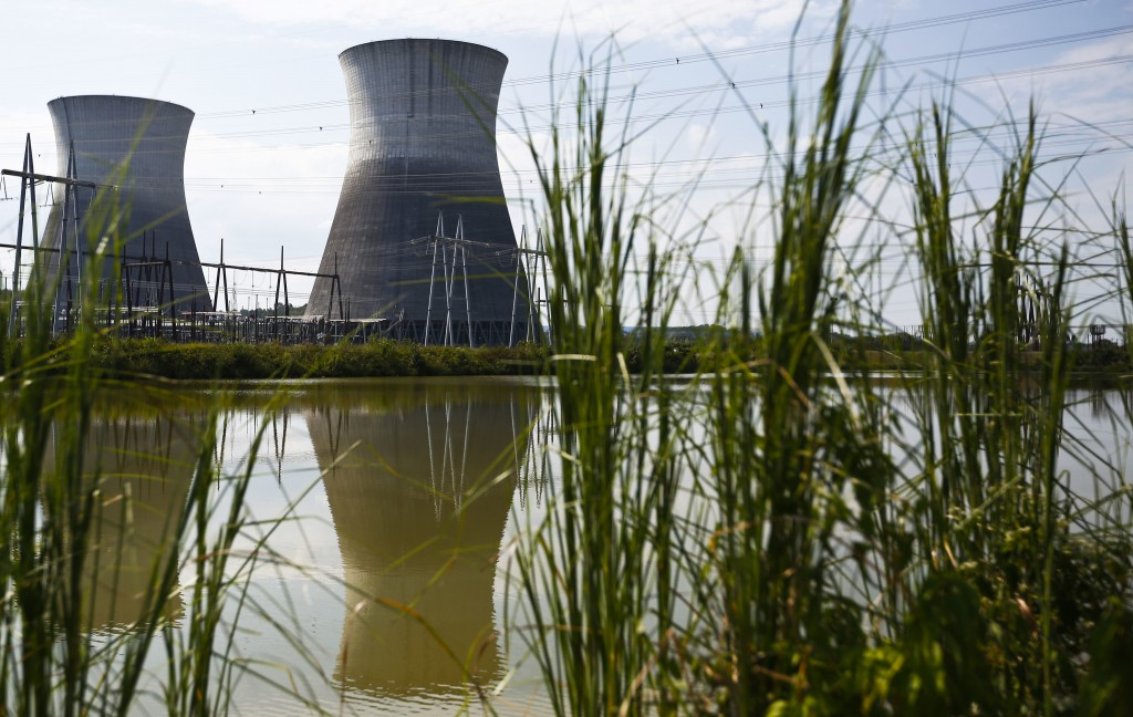 FILE - In this Wednesday, Sept. 7, 2016 file photo, two cooling towers can be seen in the reflection of a pond outside of the unfinished Bellefonte Nu...