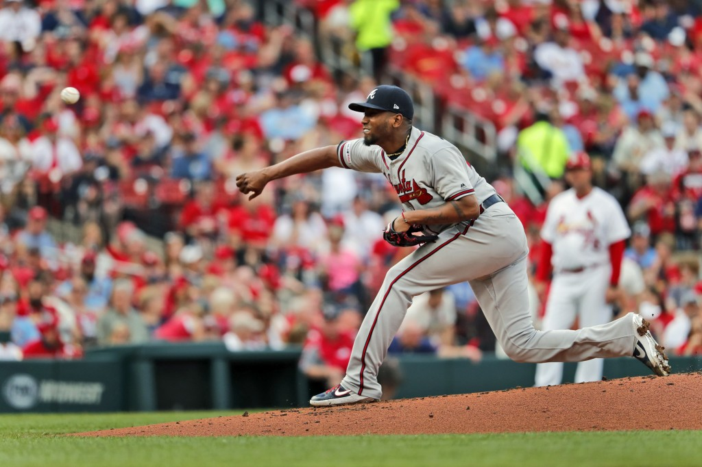 Atlanta Braves starting pitcher Julio Teheran throws during the first inning of a baseball game against the St. Louis Cardinals, Sunday, May 26, 2019,...
