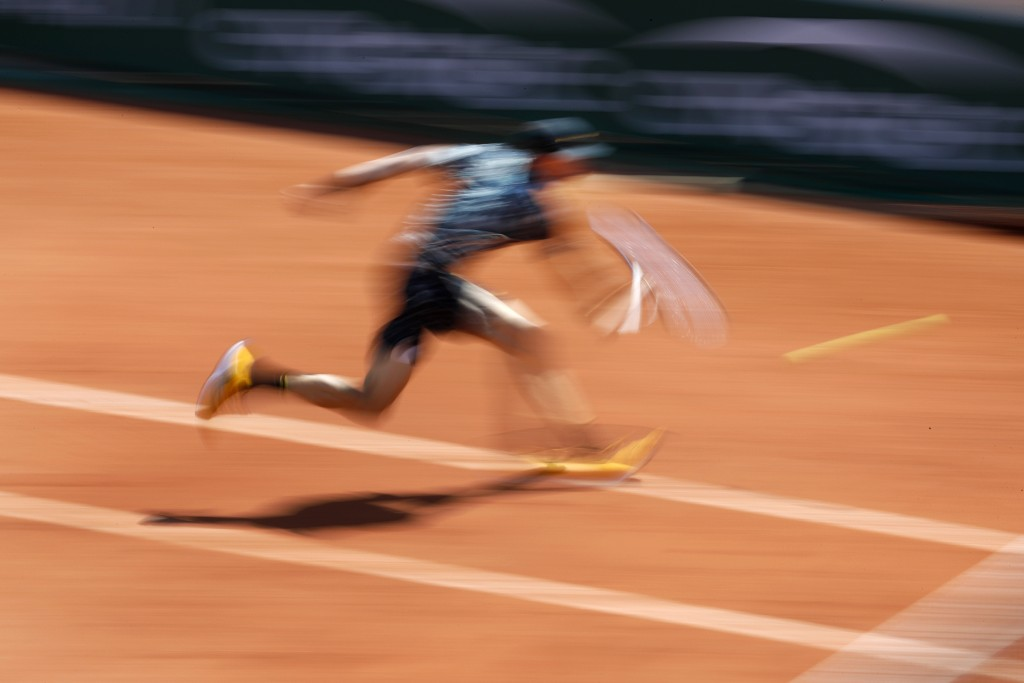 Chile's Nicolas Jarry plays a shot against Argentina's Juan Martin del Potro during their first round match of the French Open tennis tournament at th...
