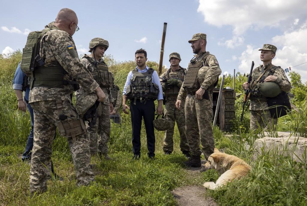 Ukrainian President Volodymyr Zelenskiy talks with servicemen as he visits the war-hit Luhansk region, eastern Ukraine, Monday, May 27, 2019. (Ukraini...