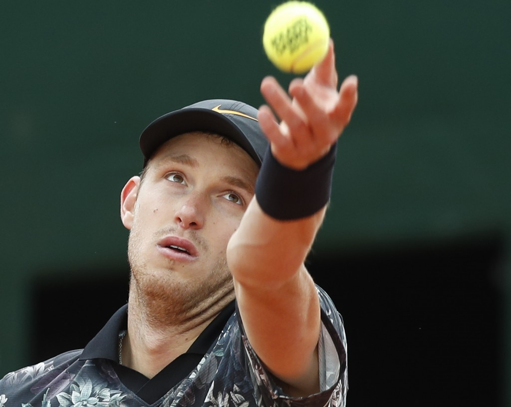 Chile's Nicolas Jarry serves against Argentina's Juan Martin del Potro during their first round match of the French Open tennis tournament at the Rola...