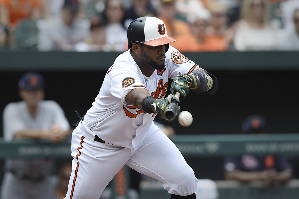 Baltimore Orioles' Hanser Alberto bunts for a base hit against the Detroit Tigers in the first inning of a baseball game Monday, May 27, 2019, in Balt...