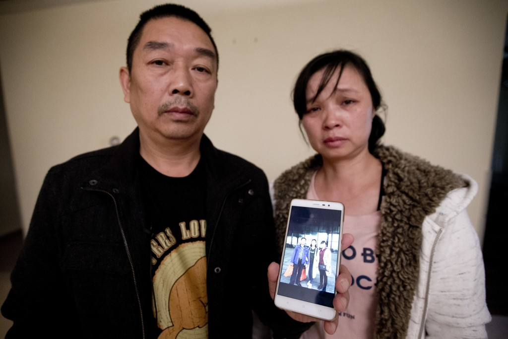 FILE- In this Nov. 1, 2017 file photo, Ronggao Zhang, left, and Lifeng Ye, display a photo them with their missing daughter, Yingying Zhang, in Urbana...