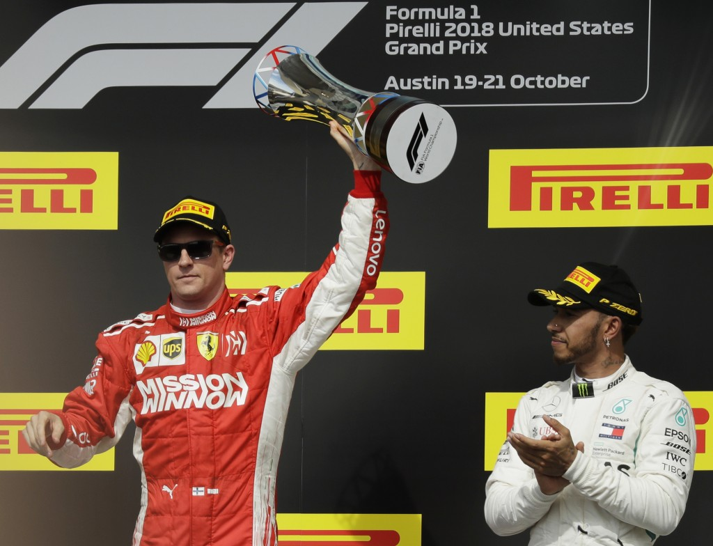 FILE - In this Oct. 21, 2018, file photo, Ferrari driver Kimi Raikkonen, of Finland, holds the trophy after winning the Formula One U.S. Grand Prix au