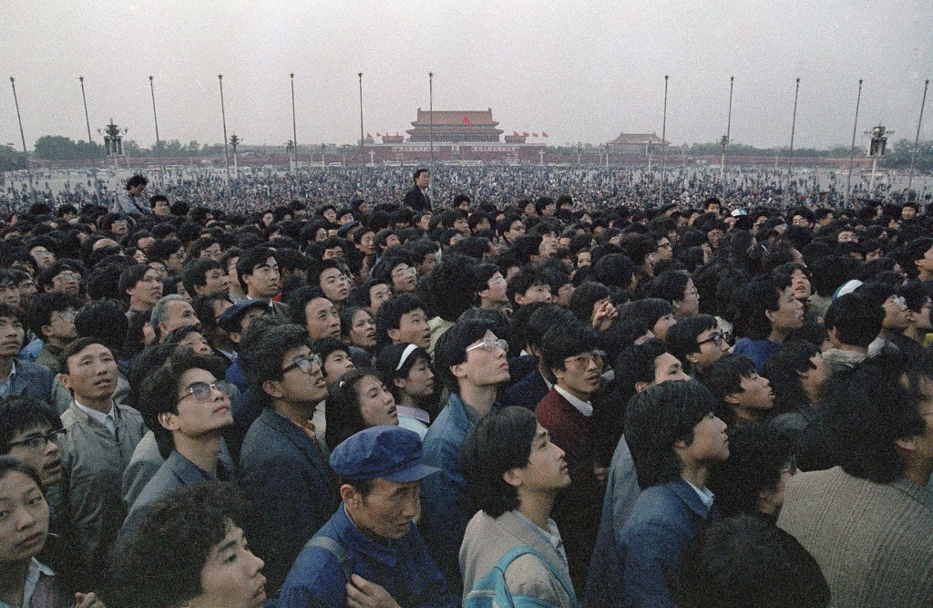 FILE - In this April 21, 1989 file photo, tens of thousands of students and citizens crowd at the Martyr's Monument at Beijing's Tiananmen Square. Ove