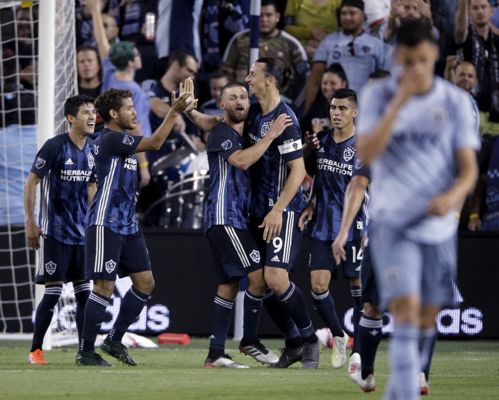 LA Galaxy forward Zlatan Ibrahimovic (9) celebrates with teammates after scoring a goal during the second half of an MLS soccer match against the Spor...