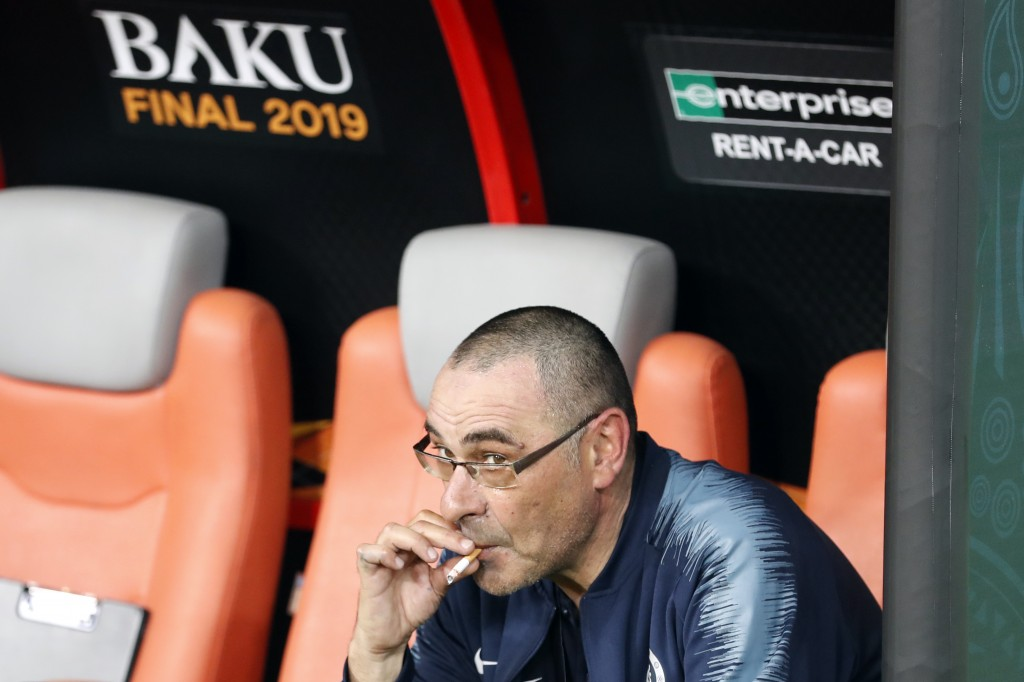 Chelsea head coach Maurizio Sarri smokes a cigarette on the bench after winning the Europa League Final soccer match between Chelsea and Arsenal at th...