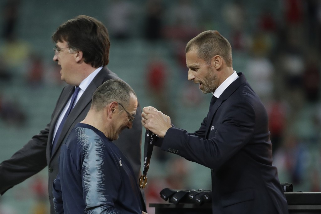 Chelsea head coach Maurizio Sarri receives his gold medal during the medal ceremony of the Europa League Final soccer match between Arsenal and Chelse...