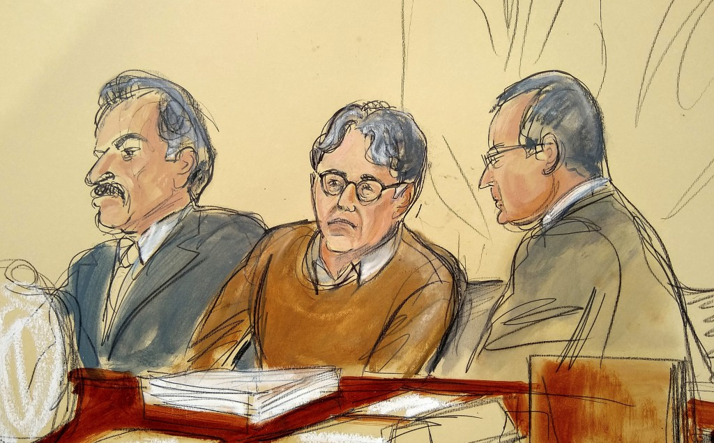 FILE - In this Tuesday, May 7, 2019 file courtroom drawing, defendant Keith Raniere, center, leader of the secretive group NXIVM, is seated between hi...