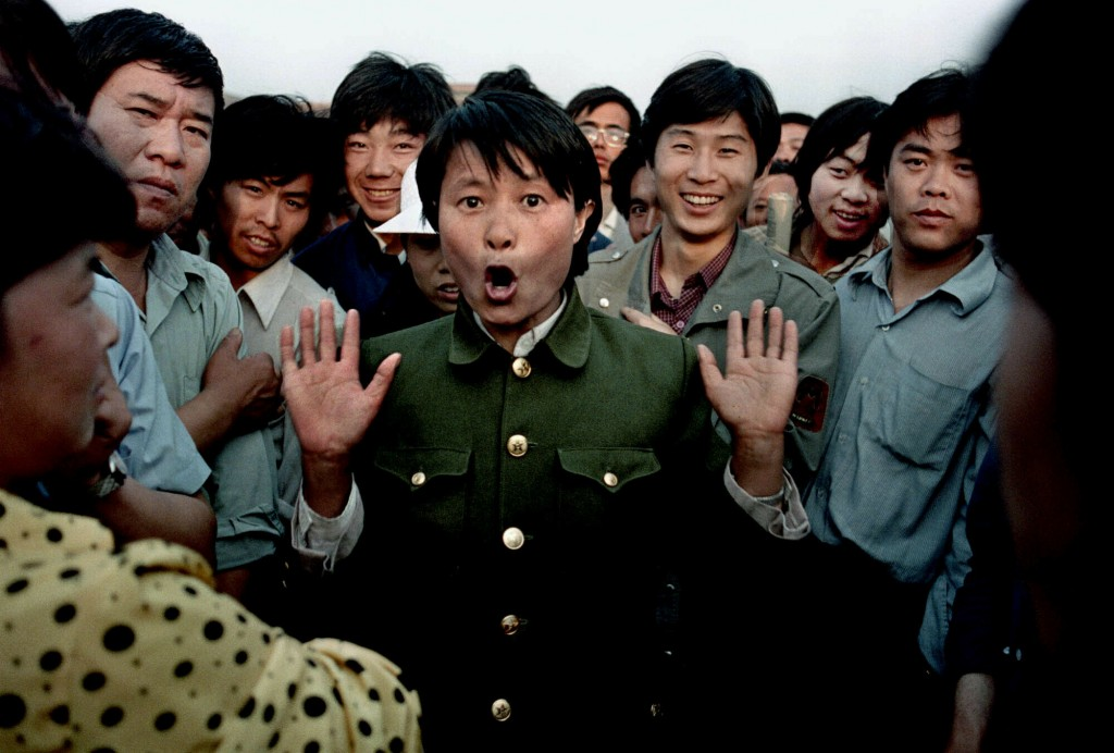 FILE - In this June 2, 1989 file photo, a woman soldier sings among pro-democracy protesters occupying Beijing's Tiananmen Square. Police and military