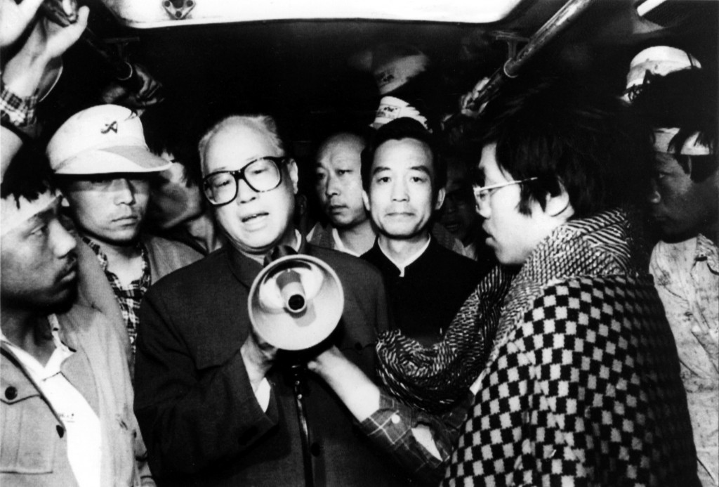 FILE - In this May 19, 1989, file photo, Communist Party General Secretary Zhao Ziyang speaks with fasting university students in Beijing's Tiananmen