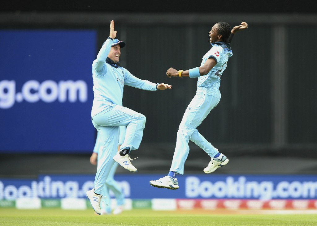 England's Jofra Archer, right, celebrates with teammate Jason Roy after taking the wicket of South Africa's Aiden Markram during their Cricket World C...
