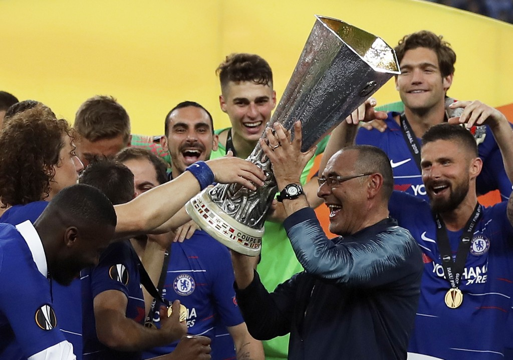 Chelsea head coach Maurizio Sarri lifts the trophy after winning the Europa League Final soccer match between Chelsea and Arsenal at the Olympic stadi