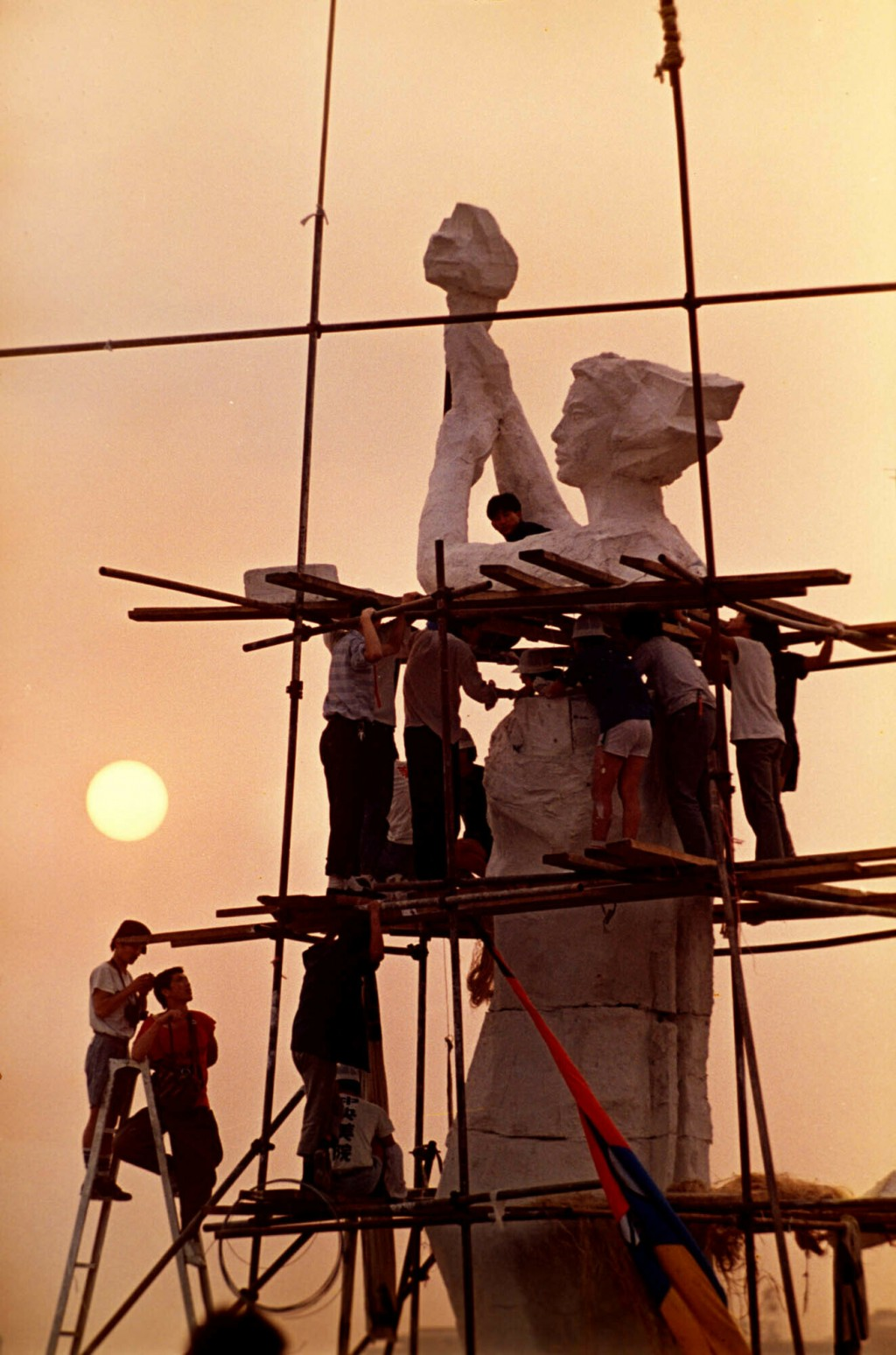 FILE - In this May 30, 1989 file photo, protesters occupying Beijing's Tiananmen Square work on the statue of the Goddess of Democracy. The makeshift