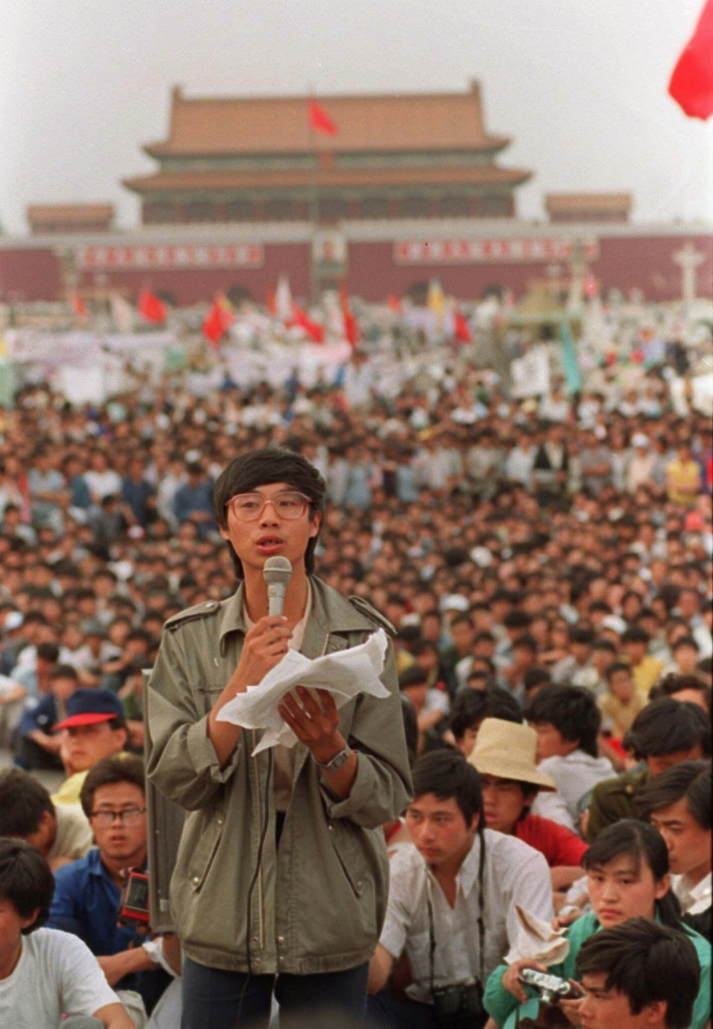 FILE - This May 27, 1989, file photo shows student leader Wang Dan in Tiananmen Square in Beijing, calling for a city wide march. Wang is urging Weste