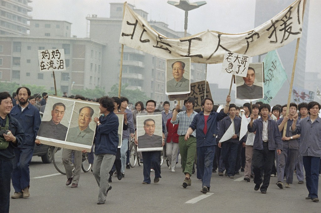 FILE - In this May 18, 1989 file photo, pro Democracy demonstrators carry portraits of former Chinese rulers Mao Tse-Tung and Chou En-Lai as they marc