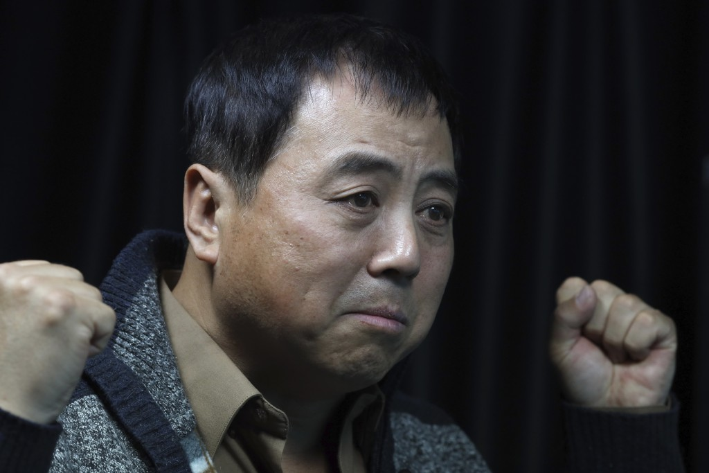 In this April 28, 2019, photo, Dong Shengkun gestures as he recalls his experience of the 1989 pro democracy protests during an interview in Beijing. ...