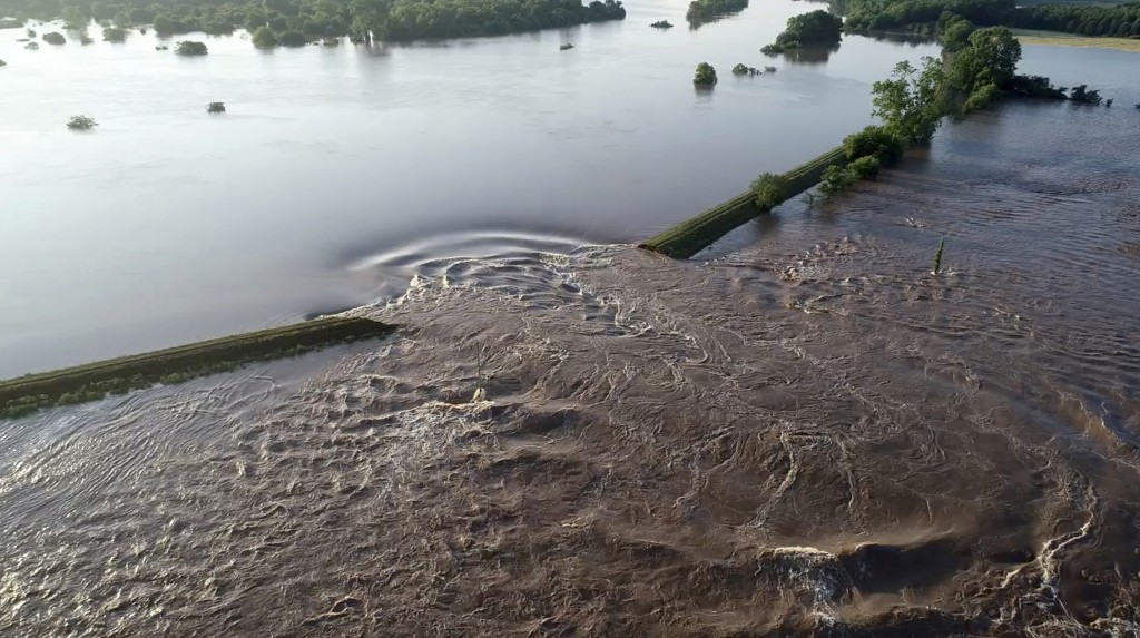 In this aerial image provided by Yell County Sheriff's Department water rushes through the levee along the Arkansas River Friday, May 31, 2019, in Dar...