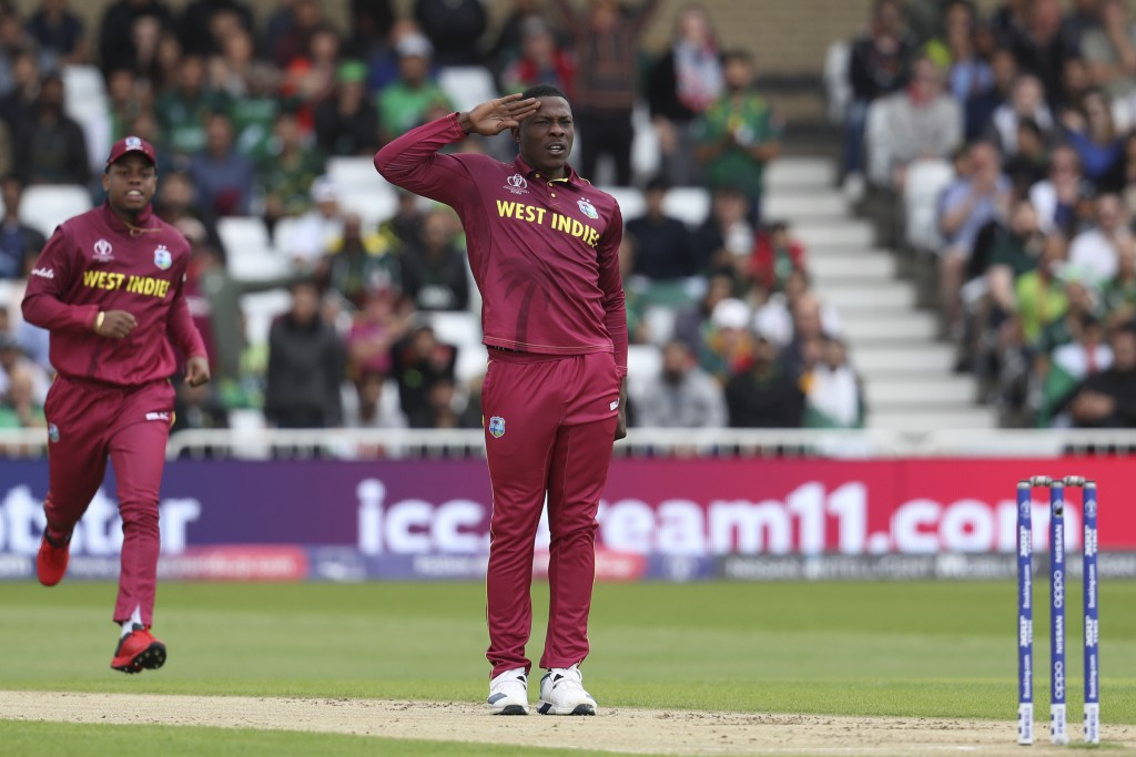 West Indies' Sheldon Cottrell celebrates taking the wicket of Pakistan's Imam-ul-Haq during their Cricket World Cup match at Trent Bridge cricket grou...