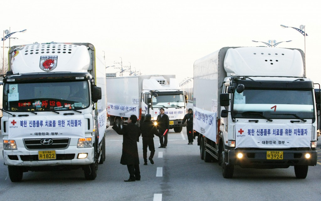FILE - In this Dec. 18, 2009, file photo, South Korean trucks transporting the Influenza medicine Tamiflu and Relenza get ready to leave for North Kor