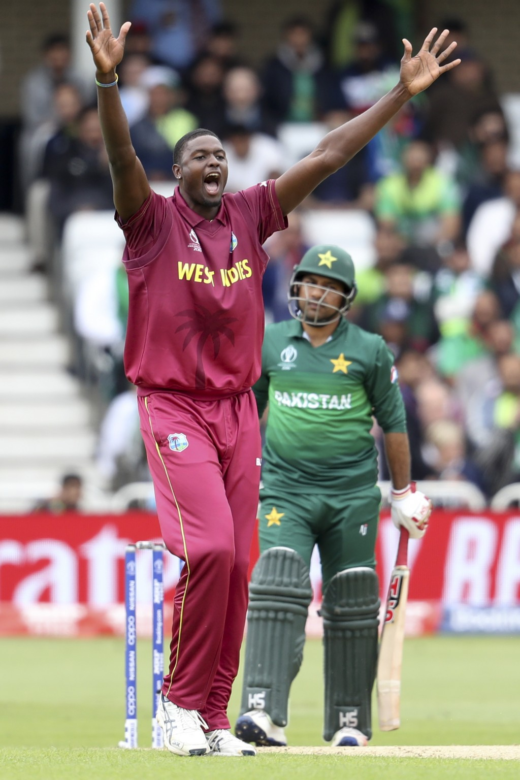 West Indies' captain Jason Holder successfully appeals for the wicket of Pakistan's captain Sarfaraz Ahmed, back, during their Cricket World Cup match...