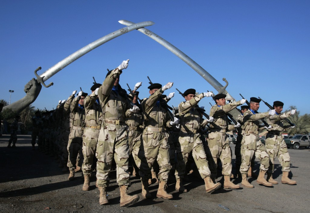 """FILE - In this Jan. 3, 2009 file photo, Iraqi soldiers practice ahead of the Army Day parade at the  """"Victory Arch"""", in Baghdad's Green Zone, Iraq. Th"""
